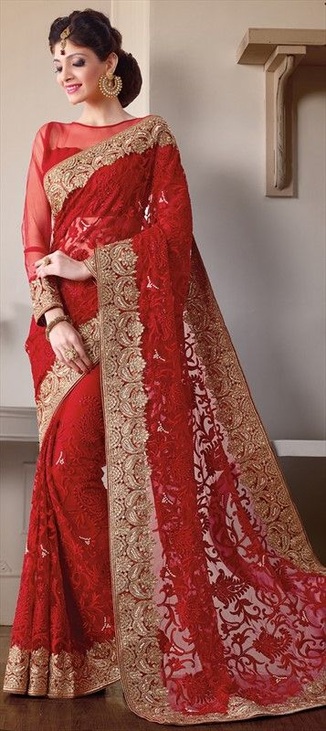 156790: BRIDAL WEAR - a red saree is what you need to complete the wedding wardrobe.