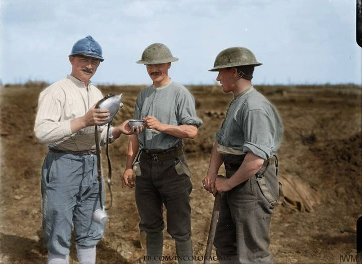 """peashooter85: """"A French soldier shares a canteen of wine with two British soldiers, 1917, World War I. """""""