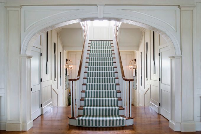 What an entrance foyer! striped carpet runner, love the molding details. Architecture by Historical Concepts, interior design by Tammy Connor, photographed here by Jean Allsopp