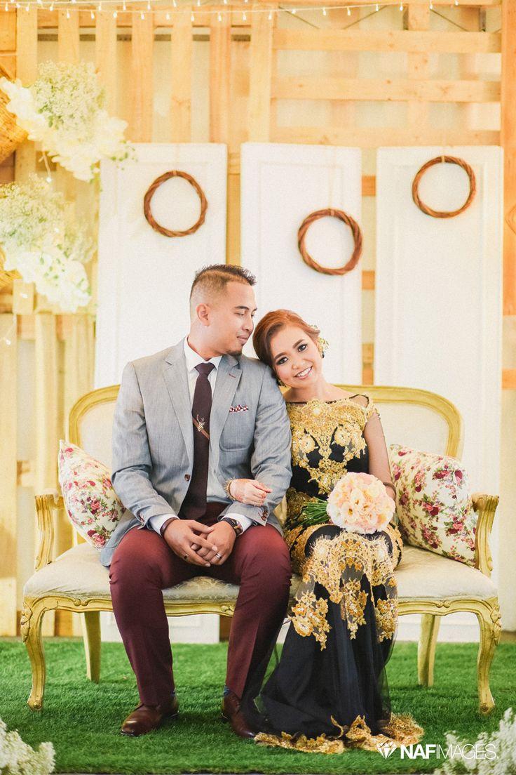 Modern Malay wedding dais decor with a rustic vintage theme.