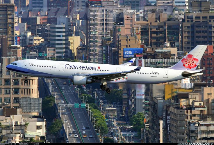 Airbus A330-302 from China Airlines on final to Sung Shan Intl Airport and overflying Taipei city. Taiwan, May 22, 2012.