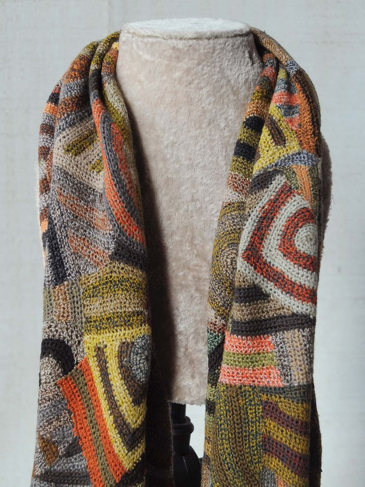 Sophie Digard's scarves and accessories are intricately hand crocheted with natural materials including Merino wool and fine linen. Established in 1999, Sophie Digard, originally from France, is a leg