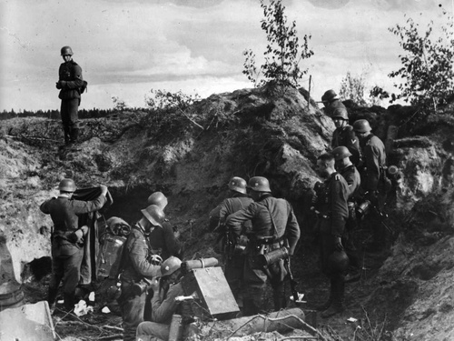 German troops inspect Soviet trenches during Operation Barbarossa.