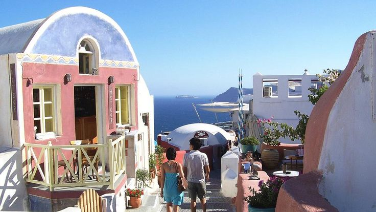 It wasn't only the Minoans who may have drawn inspiration from the island's palette. Today's residents employ a range of colors, too. While many of the island's buildings are white, others, like those shown here in Oia, range from robin's-egg blue to salmon-pink.  http://esperas-santorini.com/  #santorini #oia #color #greece