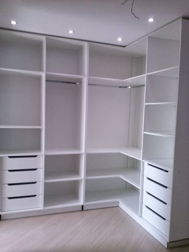 Wardrobes- bed moved over to create more storage with very narrow walk way on other side