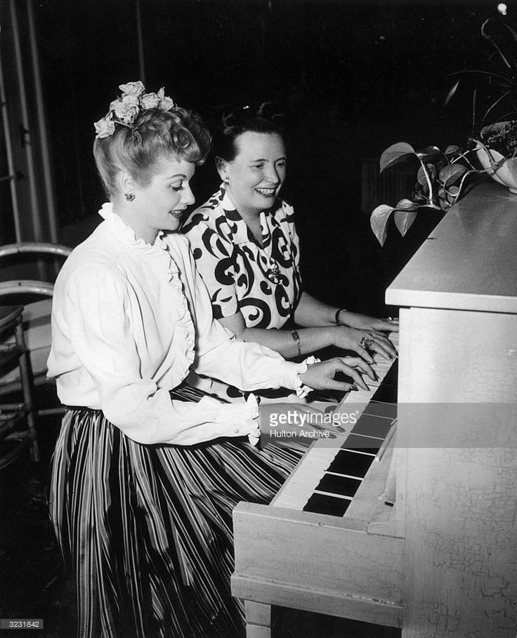 American actor and comedian Lucille Ball (1911-1989) plays the piano with her mother, concert pianist Desiree Ball, on her farm in Chatsworth, California. She was shooting director Edward Buzzell's film, 'Easy to Wed' at the time.