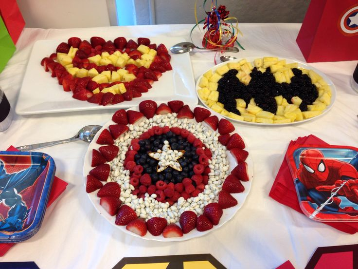 Teen titans party food ideas Superhero fruit trays! Could do this with Robins symbol.