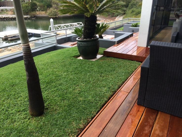 8. After photo. This outdoor area was really transformed using spotted gum timber, which added warmth and appeared to make the area look larger. Gone are the unsightly pink cracked  slippery tiles.