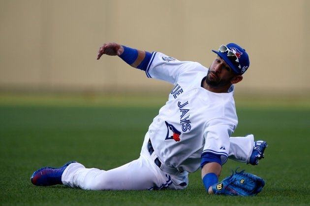 American League All-Star Jose Bautista #19 of the Toronto Blue Jays makes a diving catch on a ball hit by National League All-Star Ryan Braun #8 of the Milwaukee Brewers in the second inning during the 83rd MLB All-Star Game at Kauffman Stadium on July 10, 2012 in Kansas City, Missouri