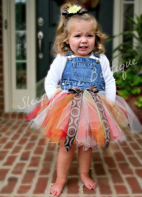 This overall tutu outfit is sure to turn heads! Dress up your cutie with an outfit that will grow with her! Perfect for photo shoots, birthdays, or play time! These are sewn for extra durability, as is the headband that comes with it! I can do any colors of the rainbow, so let me know what colors...