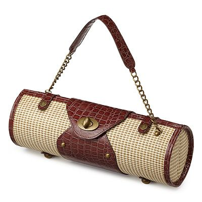 Carry your wine in style with this padded, vintage inspired wine purse.... clearly caramel and I will have to find where this are sold asap!
