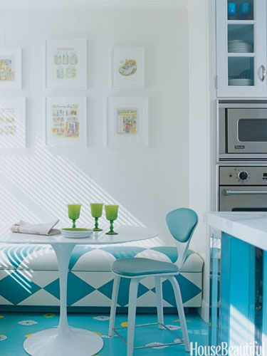 In this Manhattan apartment's kitchen, designers William Diamond and Anthony Baratta added a playful citrus pattern to bright blue floors.