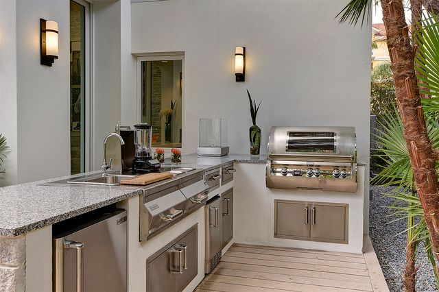 Beautiful outdoor kitchen at the new american home 2012 for Outdoor kitchen designs orlando