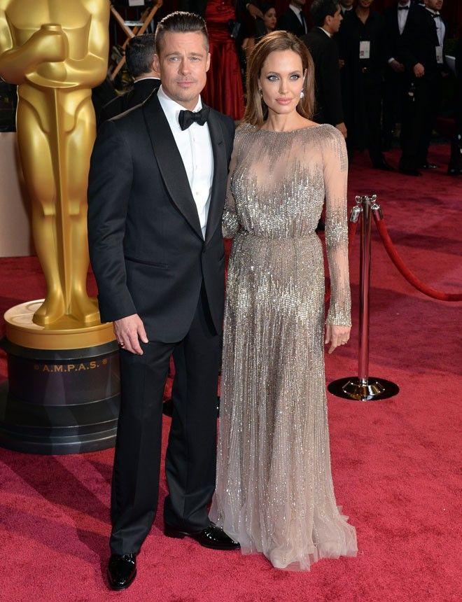 Angelina Jolie http://www.marie-claire.es/moda/look/fotos/alfombra-roja-oscar-2014-las-mejor-vestidas/angelina-jolie-8