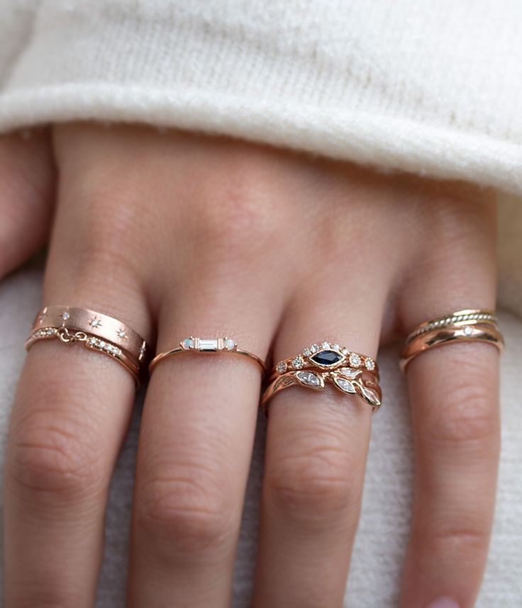 This delicate band places five diamonds in the perfect little arch. Perfectly dainty, unique, and timeless. 14k yellow gold. Worn with: Compass Ring