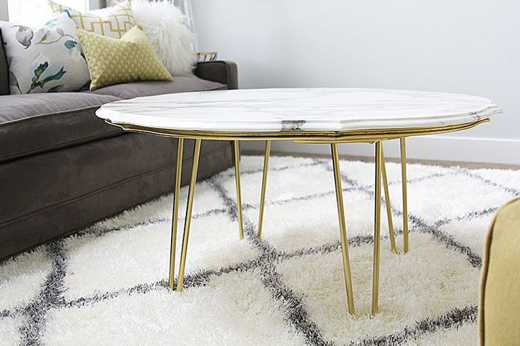 Create this beautiful mid-century diy marble top coffee table for a fraction of retail price with this tutorial.