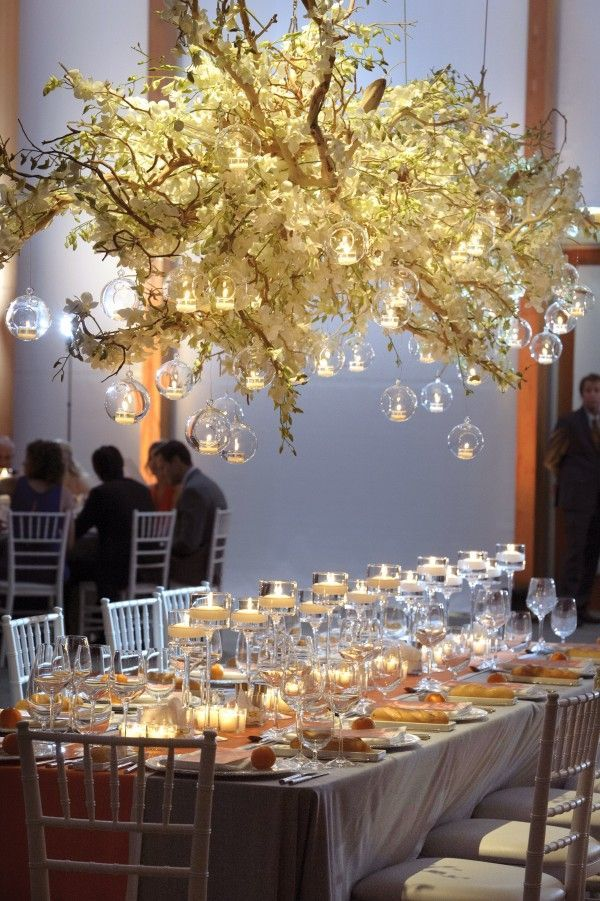 Table Setting with overhanging floral lighting  http://thebridaldetective.com/trends-we-love-hanging-wedding-decor