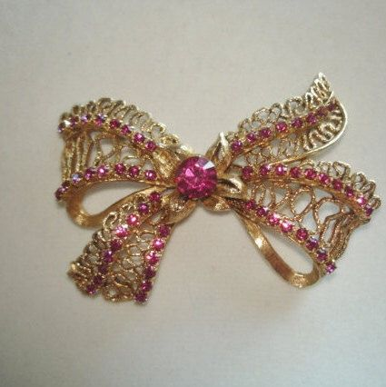 Vintage Signed Florenza Rhinestone Bow  Gold Tone Jewelry  Brooch by sanibelsands on Etsy https://www.etsy.com/listing/211040414/vintage-signed-florenza-rhinestone-bow