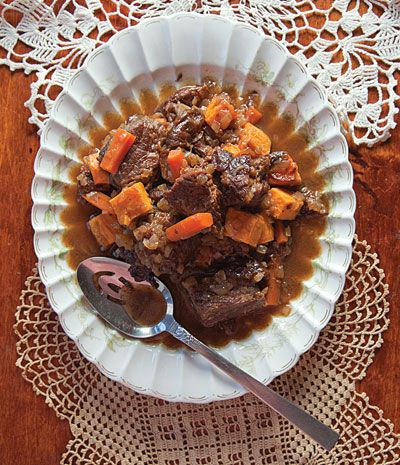 Tzimmes (Root Vegetable Stew) | Sweetened with honey and prunes, this stew is an autumn staple at Jewish holiday tables. This recipe first appeared in our October 2011 issue along with Katie Robbins's story Season of Rejoicing. | From: saveur.com