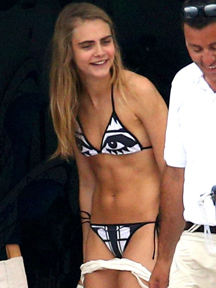 Model of the moment Cara Delevigne keeps things fun in a bikini covered in a face! Why not go quirky with your swimwear this summer.