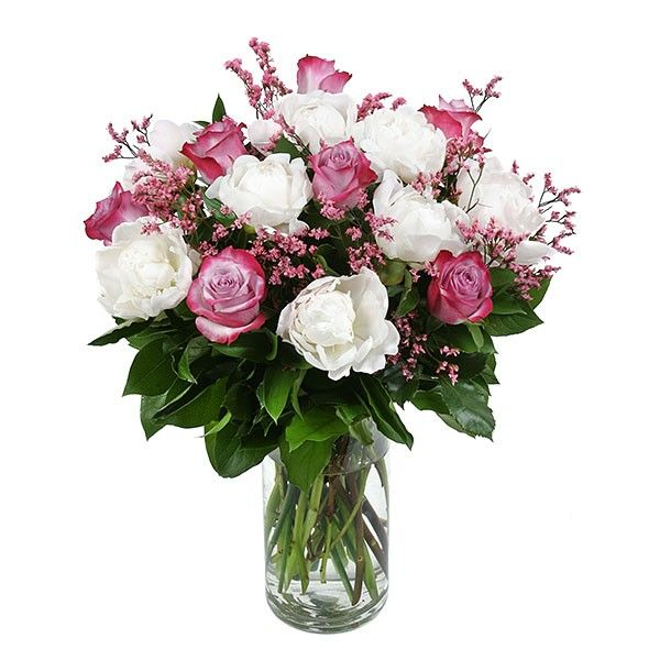PlantShed | NYC's Spectacular Pink Peonies | Same-day Flower Delivery NYC | Celebrate any occasion with this magnificent array of white peonies, purple roses and pink caspia, delicately arranged in a round glass vase.