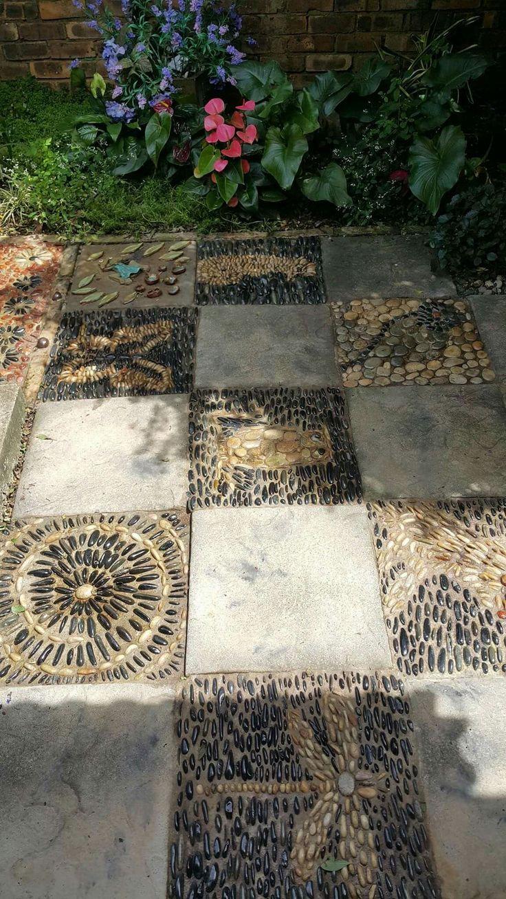 Pebble mosaics by Designer SP Botha owner of Designer Gardens Landscaping www.designergardenlandscaping.co.za