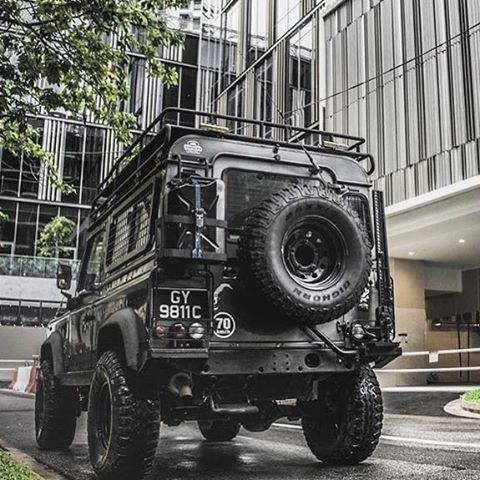 Land Rover Defender 90 Td4 customized adventure extreme rear view. Nice too much.