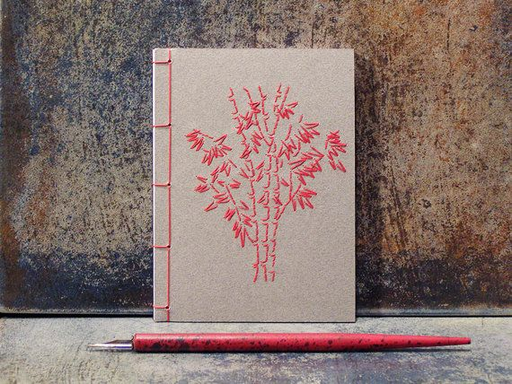Bamboo Trees. Embroidered A6 Notebook. Grey A6 Notebook. Gray Nature Notebook. Red Bamboo. Mini Journal. Pocket Notebook. Garden Mini Book  This small Japanese-style notebook is made by using a traditional stab binding technique. Front cover of a grey card stock, hand embroidered with Bamboo Trees in vibrant red cotton threads. On the inner side, the cover is finely lined for smooth writing. Bound with red jad string. Contains approx. 50 sheets of plain white european paper (100 pages front…