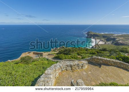 http://www.shutterstock.com/pic-217959964/stock-photo-cape-point-is-located-near-the-city-of-cape-town-south-africa-the-peninsula-has-towering-rock.html?src=nc-7G7zJJhy98zULYPu3ow-1-20 Cape Point Is Located Near The City Of Cape Town, South Africa. The Peninsula Has Towering Rock Cliffs And Lighthouse That Overlook The Beautiful Ocean View. A Tourism And Travel Hot Spot. Stock Photo 217959964 : Shutterstock