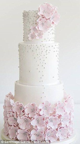 Floral fondant: The dramatic sweep of sugar flowers is  classic and pretty but still makes a strong statement