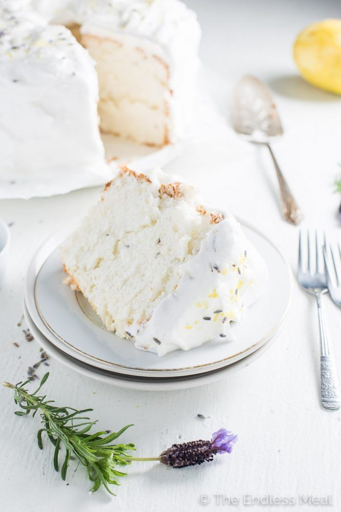 Lavender Lemon Angel Food Cake is light, fluffy and so delicious. It's covered in an easy to make meringue frosting and sprinkled with lemon zest and lavender flowers. It's a beautiful and surprisingly easy dessert to make. | theendlessmeal.com