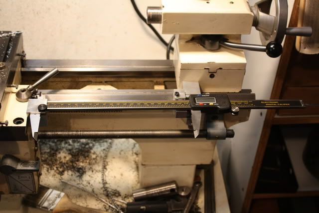 "Lathe DRO by Marc M -- Homemade DRO for a small lathe. Chinese 12"" calipers are mounted on a cam-lock style mount on the lathe way. The opposite end is secured to the mounting block on the carriage with a thumbscrew. http://www.homemadetools.net/homemade-lathe-dro"