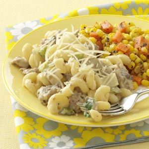 Sausage Alfredo Recipe - 3-1/2 cups uncooked spiral pasta  1 pound bulk Johnsonville® Ground Sausage  1 medium green pepper, chopped  1 large onion, chopped  1 can (4 ounces) mushroom stems and pieces, drained  1 jar (15 ounces) roasted garlic Alfredo sauce  1/4 cup shredded Parmesan cheese