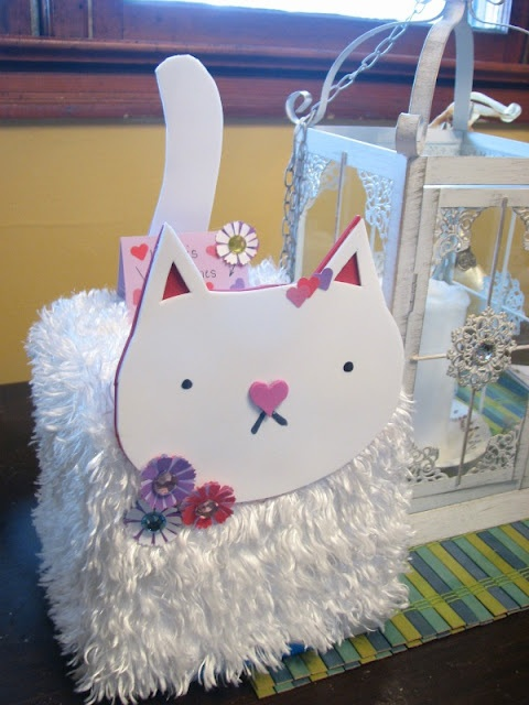 Lizzy's Valentine's card box. Made from ice cream tub, foamy, faux fur, and embellishments.