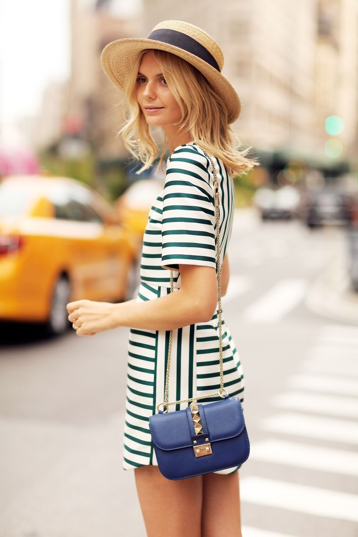 Striped mini dress + straw hat and chic cross-body = perfect summer look