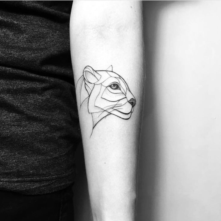 Lioness tattoo by Ira Shmarinova.   Blackwork animal tattoos are classy & mysterious. They stand out due to their bold lines and complex patterns and they impose respect and admiration. Enjoy!