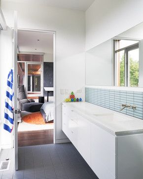 Like this floating vanity, wall and floor tile. In-wall fixture is cool and keeps the countertop clean, but doesn't seem too conducive for repairs? Even has a floor register like we have in the bathroom too!