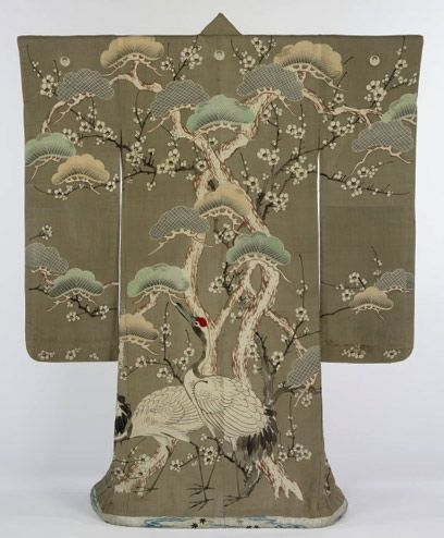 Kimono: 1850-1900.  The design of this kimono illustrates the close connection between painting and textile arts that exists in Japan. The surface of the garment has acted as a kind of hanging scroll for the creation of a hand-painted and dyed image of cranes among pines and plum blossoms. Touches of embroidery have been used to highlight the crests of the birds and parts of the pine boughs.