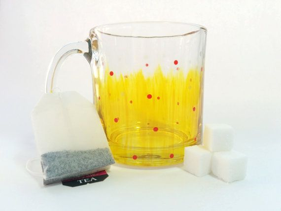 Enjoy your favorite hot or cold beverages in this sturdy, hand-painted clear glass mug. The mug holds 13 oz and is painted with glass paints that have been heat set for maximum durability.  Theres something extremely satisfying about a mug you can see through; being able to see sunlight shine through your tea, or to admire the bright colors of the hand-painted design against a bright white cup of milk or a dark black cup of coffee. Of course, you dont just have to drink things out of mugs…