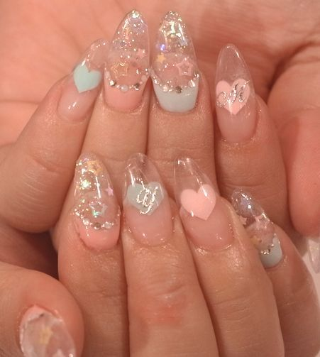 Stiletto acrylic nails something like fairy kei http://cutenail-designs.com/