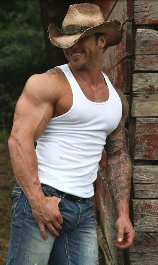 something so sexy about a man in a wife beater