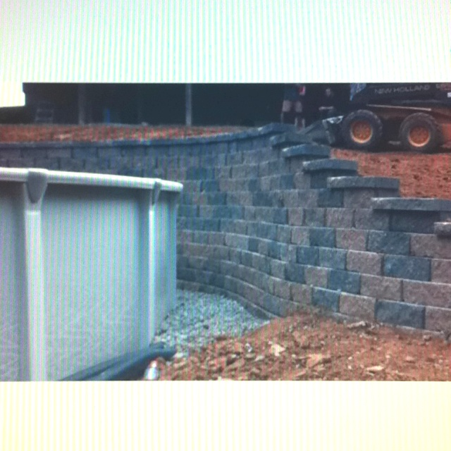 Swimming Pool Wall Construction : Landscaping wall around an above ground pool looks