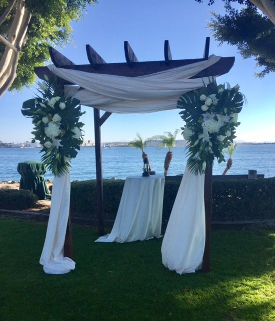 This waterfront wedding was a dream in person. We love the tropical vibes our florist created with these arch pieces.