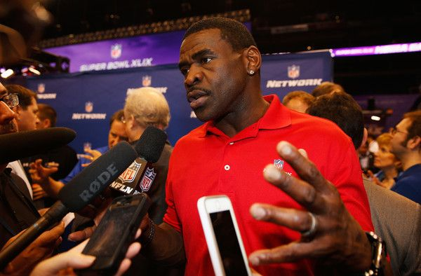 Michael Irvin Photos Photos - NFL Network personality Michael Irvin addresses the media at Super Bowl XLIX Media Day Fueled by Gatorade inside U.S. Airways Center on January 27, 2015 in Phoenix, Arizona. - Super Bowl XLIX Media Day