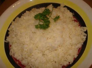 Cuban white rice...sooo addicting. Might even taste good with cilantro or lime! Reduce water to 2 1/4 cups and stick everything in the rice cooker for an even easier side dish!