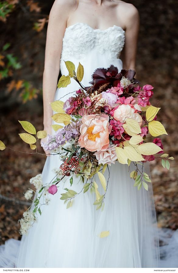 Fall inspired bridal look with an off white soft flowy dress, red head bride and hues of deep red and orange!
