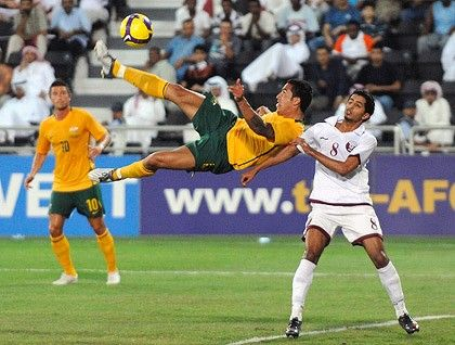 Tim Cahill attemps a spectacular goal against Qatar in the Socceroos' World Cup qualifier overnight.