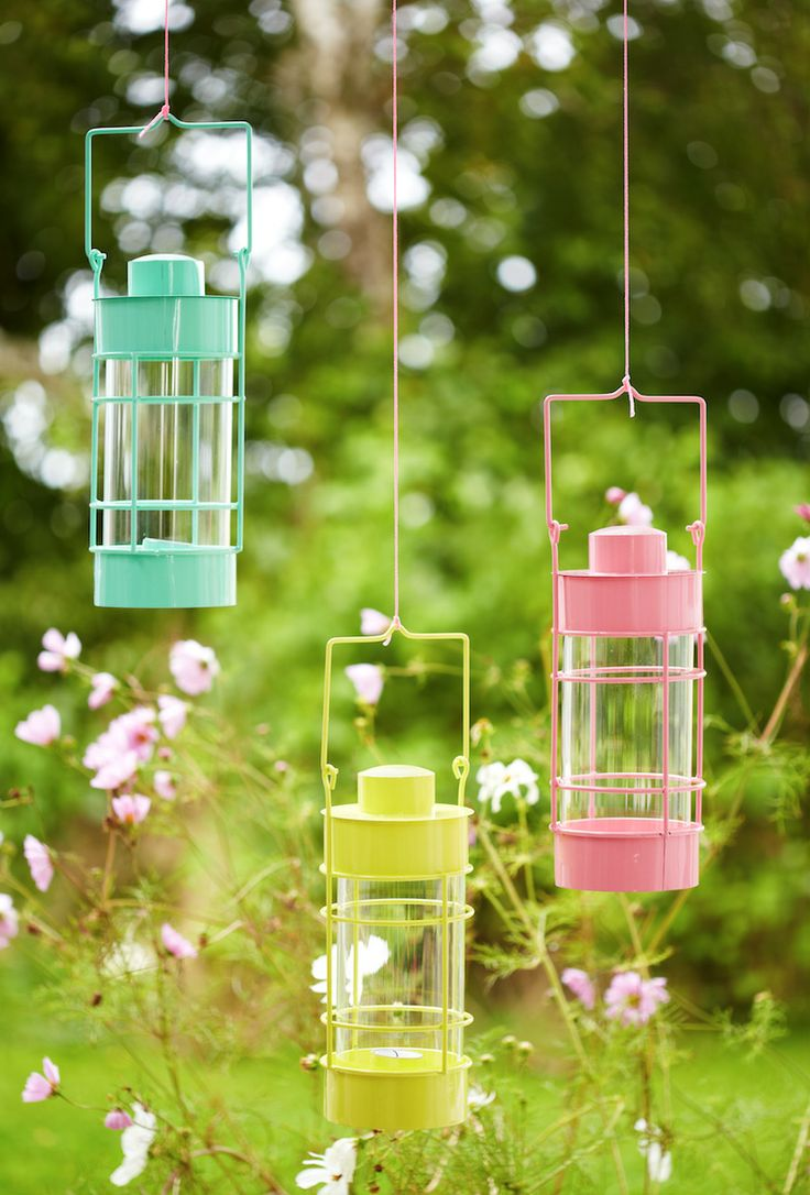 Brighten up your garden by hanging pretty lanterns off a tree branch. Lovely idea for summer nights