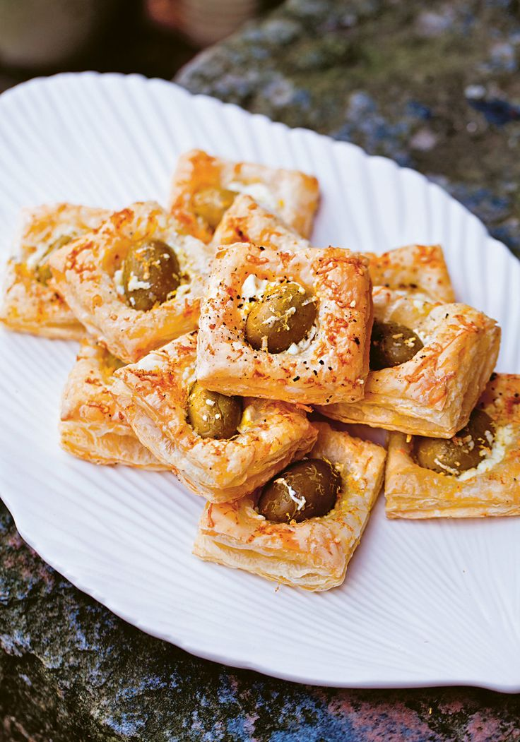 Olive Puffs with Feta Recipe || If you're a superhero, you can make your own puff pastry. But if you're an ordinary mortal, I think it's totally fine to buy frozen puff pastry. All you have to do is pop the puff pastry into the oven before your guests arrive.