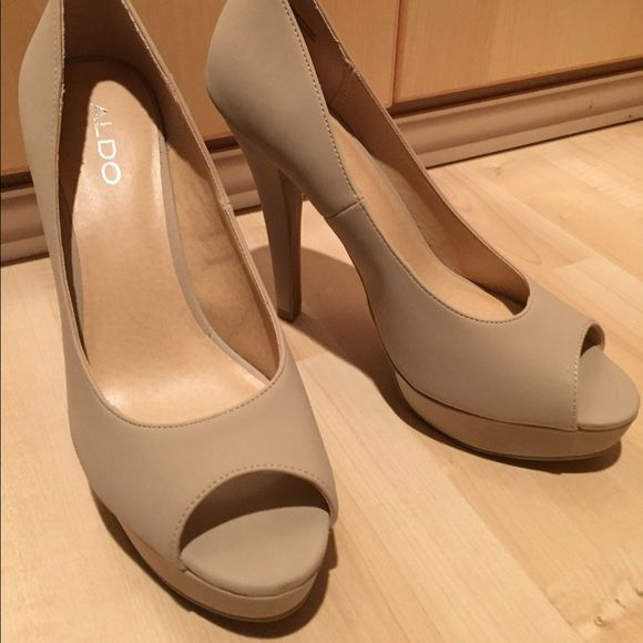 ALDO Peep Toe Platform Made by ALDO. Never Worn only tried on. Beautiful yet very sexy, Beige Colored Platform Peep Toe Sandal. No marks or scratches. ALDO Shoes Platforms